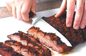 sliciing flank steak photo