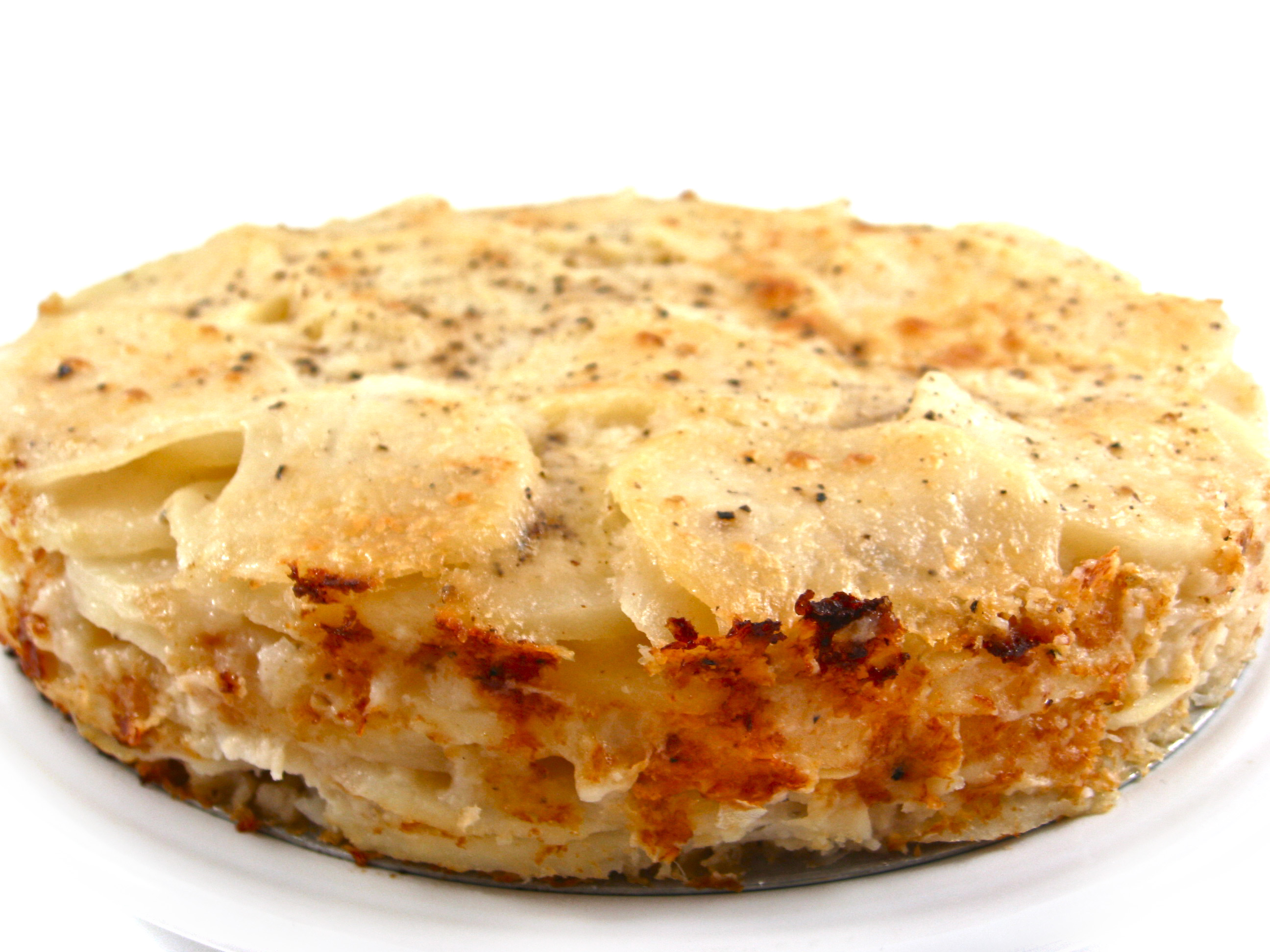 POTATOES AU GRATIN: In nonstick 9 ... baking pan. Combine potatoes ...